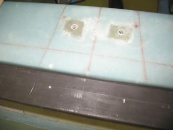 Crossbar marked by headrest holes
