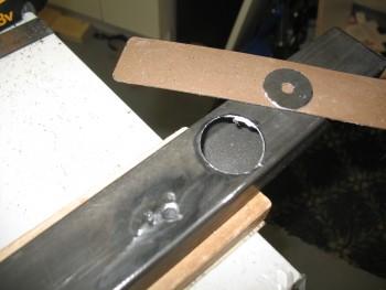 Drill right roll bar leg hole in cross bar