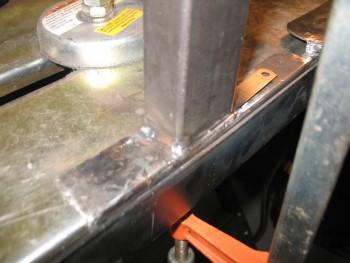 Tack welding cross bar to left side rail