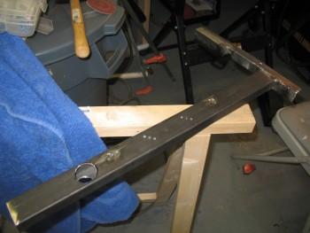 Cross bar tack welded to left side rail
