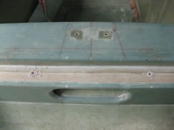 Holes for seatbelt bolt/nut clearance