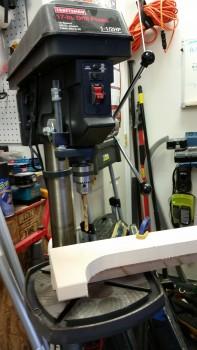 Drilling saddle mount holes