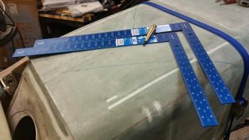 Aluminum squares & plumb bob on hand