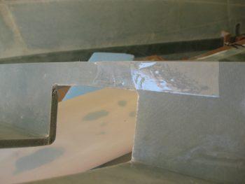 Right armrest underside taped