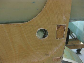 Aileron control bearing mounting hole