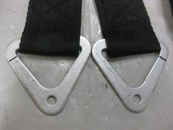 Seatbelt strap brackets marked for cutting